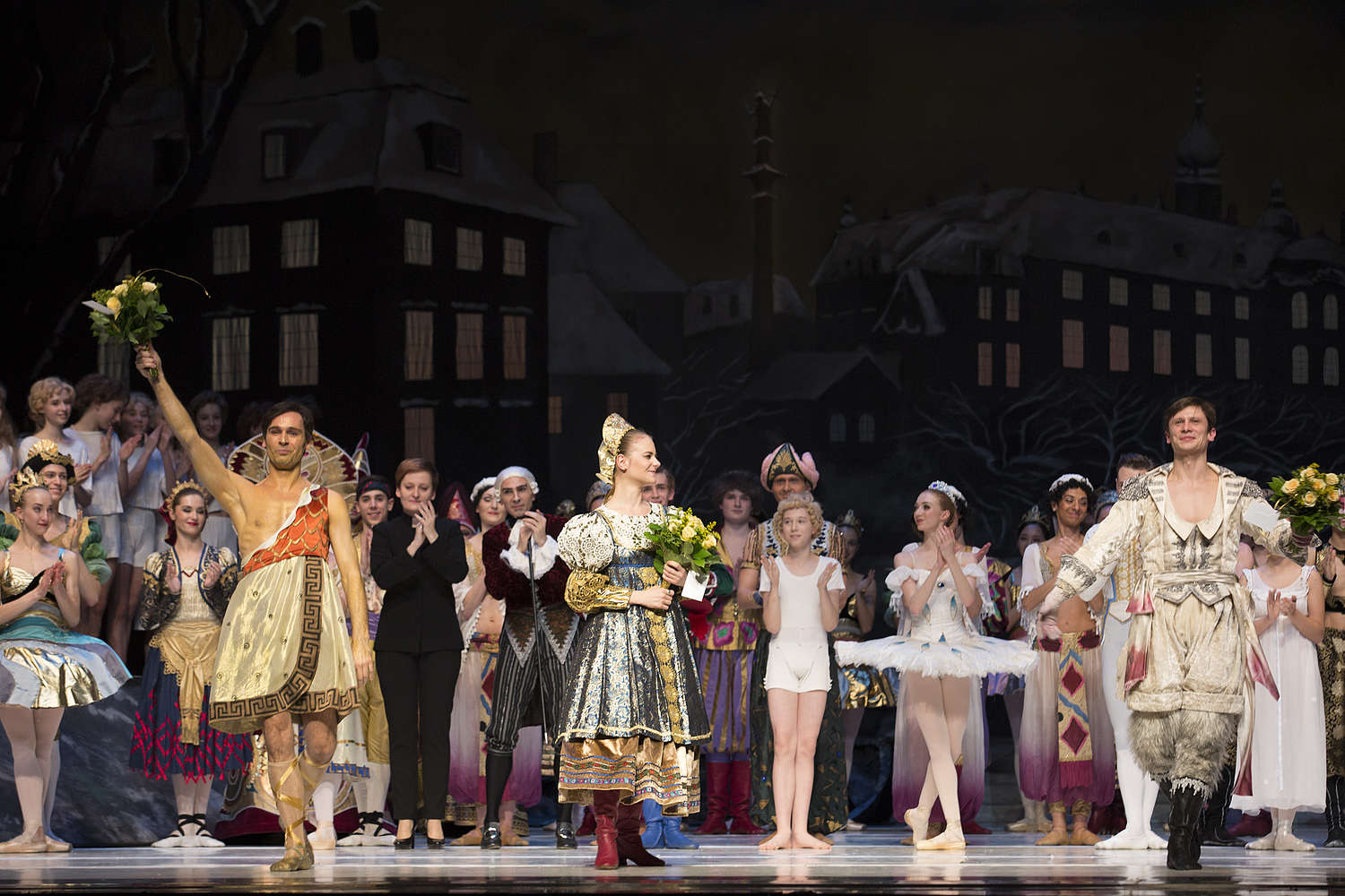 Pictured: Adam Kozal, Stella Walasik and Kurusz Wojeński during curtain call after a performance of The Nutcracker